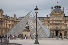 The Louvre in Paris. The famous art museum Louvre in France's capital Paris. The Louvre Pyramid (Pyramide du Louvre) is a large glass and metal pyramid designed Royalty Free Stock Photo