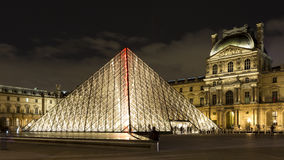 The Louvre of Paris in France by night Royalty Free Stock Image