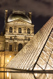 The Louvre of Paris in France by night Stock Photos