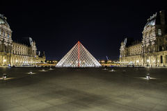 The Louvre. In Paris, France at night  museum is one of the major tourist attractions in France and in Europe stock photo