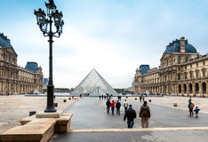 The Louvre, Paris. Paris, France. November 12, 2005. Cour Napoleon and Pyramid entrance to the Louvre museum Royalty Free Stock Photography