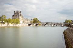 The Louvre of Paris in France with La Seine Stock Photography