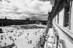 Black and white art monochrome photography. A beautiful European city. Euro-trip. The Louvre in Paris, the largest museum in the world. Louvre Pyramid. Travel Royalty Free Stock Image