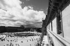 Black and white art monochrome photography. A beautiful European city. Euro-trip. The Louvre in Paris, the largest museum in the world. Louvre Pyramid. Travel Stock Images