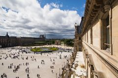A beautiful European city. Euro-trip. The Louvre in Paris, the largest museum in the world. Louvre Pyramid. Travel through Europe. Attractions in France. View of Royalty Free Stock Photos
