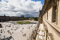 A beautiful European city. Euro-trip. The Louvre in Paris, the largest museum in the world. Louvre Pyramid. Travel through Europe. Attractions in France. View of Royalty Free Stock Images