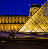 Louvre Paris. The Louvre museum in Paris, France at night royalty free stock photos