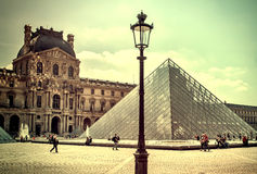 The Louvre in Paris on a sunny day. Vintage view. Louvre in Paris old retro style. Stock Photo