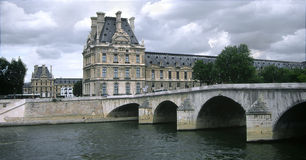 The Louvre and pont royale bridge,paris Royalty Free Stock Image