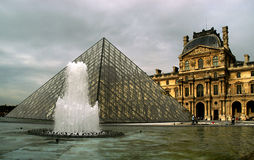 The Louvre and the Pyramid. This is the most visited museum in the world, Louvre in Paris Royalty Free Stock Photography