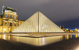The Louvre pyramid closeup view, Paris, France. stock photos