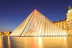 The Louvre Pyramid at dusk during the Michelangelo Pistoletto Ex Stock Image