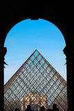 The Louvre Pyramid from the Eastern entrance Stock Photos