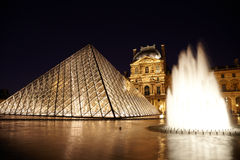 Louvre Pyramid, fountain and Pavillon Rishelieu Royalty Free Stock Photo