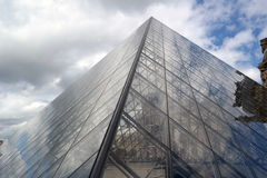 Louvre Pyramid. Light reflections in the glass pyramids and water Stock Photography