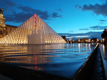 Louvre Pyramid. Light reflections in the glass pyramids and water Royalty Free Stock Photos