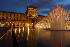 Louvre Pyramid. Light reflections in the glass pyramids and water Stock Images