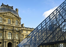 Louvre pyramid and museum Stock Images
