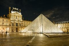 Louvre Pyramid at night stock photos