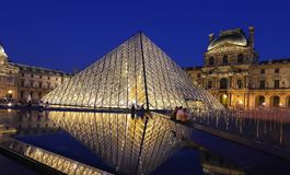 The Louvre pyramid at night , Paris, France. stock images