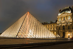 The  Louvre Pyramid at night, Paris, France. Stock Images