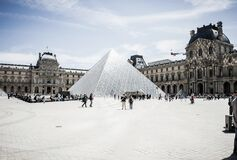 Louvre Pyramid in Paris Stock Image