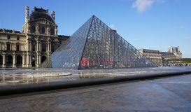The Louvre Pyramid in Paris Stock Photos