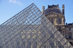 The Louvre Pyramid in Paris Stock Images