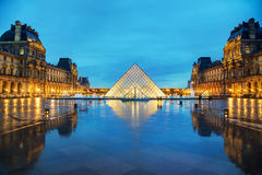 The Louvre Pyramid in Paris, France Stock Images