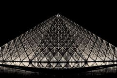 Louvre pyramid in Paris by night Stock Photography