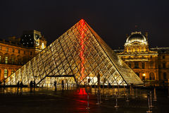 The Louvre Pyramid in Paris at night Stock Photo