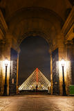 The Louvre Pyramid in Paris at night Royalty Free Stock Photos