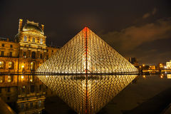 The Louvre Pyramid in Paris at night Royalty Free Stock Image