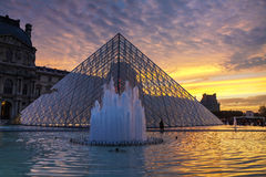 The Louvre Pyramid in Paris at sunset Royalty Free Stock Photography