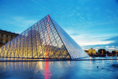 The Louvre Pyramid in Paris at sunset Royalty Free Stock Photo