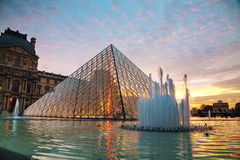 The Louvre Pyramid in Paris at sunset Stock Photo