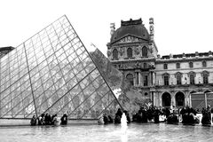 Louvre Pyramid. The Louvre Pyramid (Pyramide du Louvre) is a large glass and metal pyramid in the main courtyard (Cour Napoléon) of the Louvre Palace (Palais du Royalty Free Stock Photos