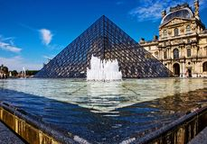 Louvre Pyramid Pyramide du Louvre angle, paris. Louvre Pyramid, Pyramide du Louvre angle with the fountain, in front of the museum, Paris, France Stock Images
