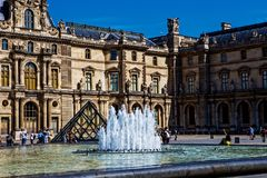 Louvre Pyramid Pyramide du Louvre plaza, paris. Louvre Pyramid, Pyramide du Louvre with the fountain, in front of the museum, Paris, France Stock Image