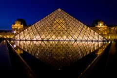 Louvre pyramid reflection Royalty Free Stock Image