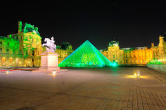 Louvre Pyramid shines at night Stock Images