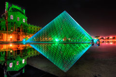 Louvre Pyramid shines at night Royalty Free Stock Photo