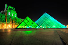 Louvre Pyramid shines at night Stock Photography