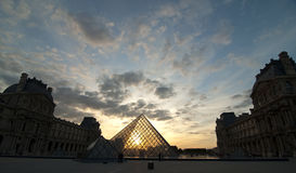 Louvre pyramid during sunset Stock Photos