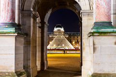 Louvre Pyramid though Arc in Paris Royalty Free Stock Images