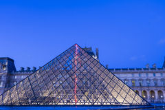 The Louvre pyramide in evening, Paris, France. Royalty Free Stock Image