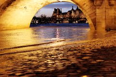 Louvre from Paris Bridge Pont Neuf Seine river floods. The louvre seen from under the Bridge Pont Neuf New Bridge by nightfall, the Seine river water level rises stock photography