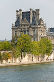 The Louvre and  the Seine River in Paris . Royalty Free Stock Image