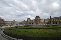 Louvre, sky, cloud, landmark, stately home. Louvre is sky, stately home and wall. That marvel has cloud, palace and daytime and that beauty contains landmark Royalty Free Stock Photography