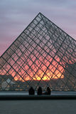 Louvre by sunset Stock Photos